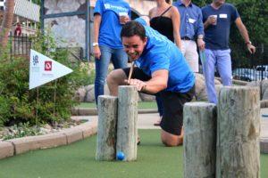 Scott Jarred using pool cue in mini-golf