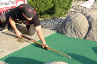 How is your aim putting with a pool cue?