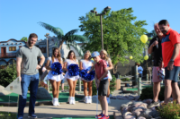 Colts' player, Jack Doyle challenges 9-year-old Walt to a friendly competition while the Colts Cheerleaders cheer him on.