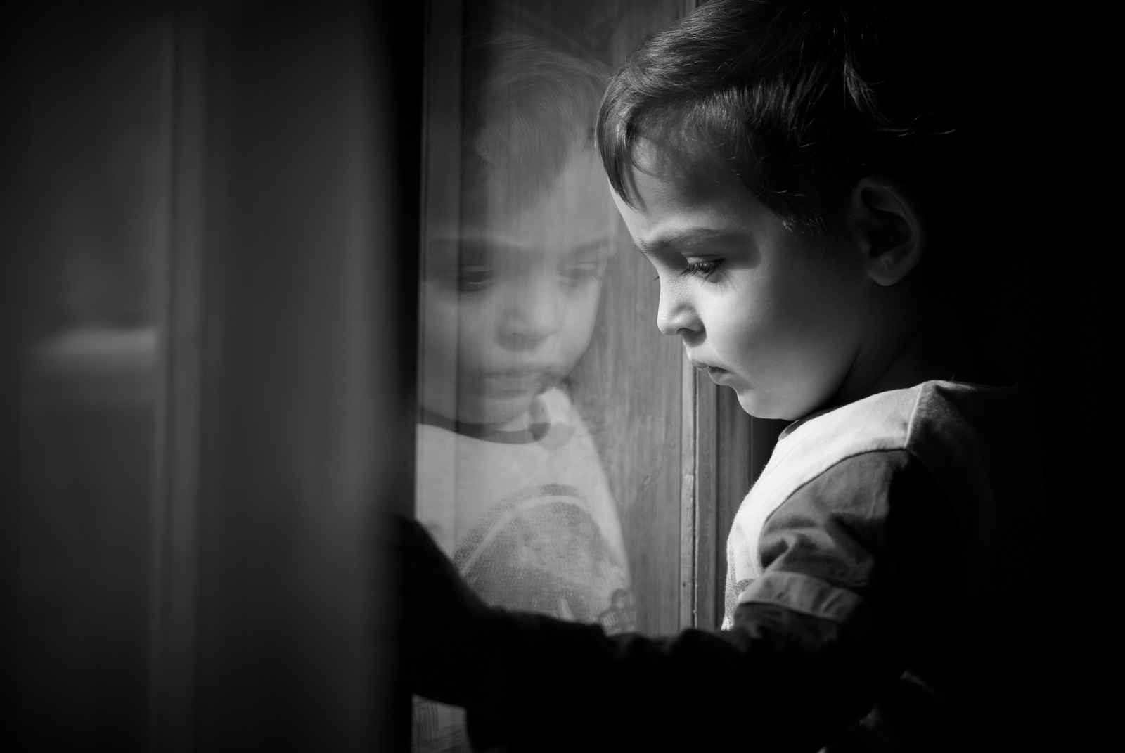 child-kid-baby-toddler-boy-girl-reflection-sad-depressed-dim-window-looking-watching-waiting-1